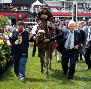 Shaman Ghost heads to the winner's circle after his May 19 Pimlico Special victory