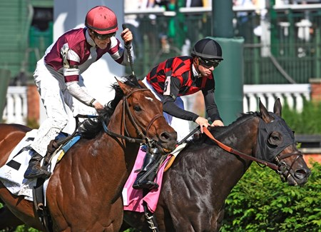 Divisidero with jockey Julien Leparoux up, left, out duels Beach Patrol with jockey Florent Geroux to the wire to win the 31st running of the Woodford Reserve Turf Classic May 6, 2017 at Churchill Downs in Louisville, Kentucky.