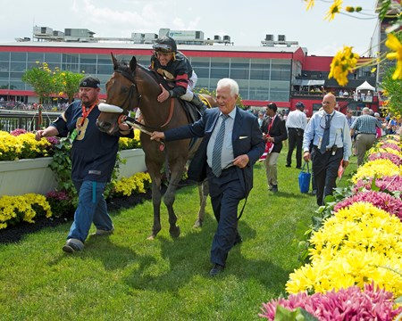 Frank Stronach leads in Shaman Ghost with Javier Castellano after the Xpressbet Pimlico Special (G3)