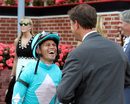 Javier Castellano and Graham Motion in the winner's circle after Happy Mesa won the 45th Running of the Hilltop Stakes at Pimlico on May 19, 2017.