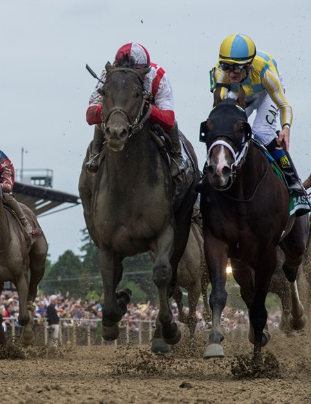 Cloud Computing with jockey Javier Castellano, left catches Classic Empire with jockey Julien Leparoux at the wire to win the 142nd running of the Preakness Stakes Saturday May 20, 2017 at Pimlico Race Course in Baltimore, MD.  Photo by