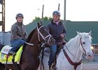 Rosie Napravnik aboard Girvin with trainer Joe Sharp on the pony
