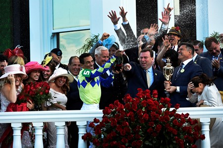 Jockey John Velazquez sprays champagne over the celebrants after winning the 143rd running of the Kentucky Derby May 6, 2017 in Louisville, Kentucky.