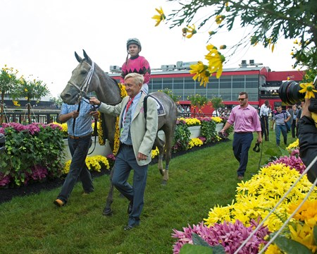 Trainer Jason Servis walkin. Actress with Nik Juarez wins the Black-eyed Susan (gr. II) for trainer John Servis and Mary and Gary West (not here). May 19, 2017 Baltimore in Pimlico, Maryland.