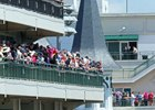Fans look out from a balcony at Churchill Downs during the 2017 Kentucky Derby