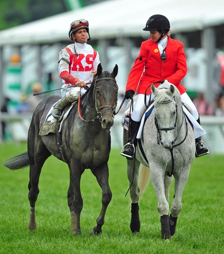 Cloud Computing and Javier Castellano on their way to the winners' circle, after winning the 142nd Preakness Stakes
