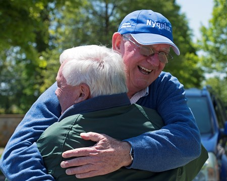 breeders Mike Ryan and Gerry Dilger (Santa Rosa) hug after seeing each other for the first time since Always Dreaming won the Kentucky Derby, pictured at Dromoland Farm near Lexington.  May 8, 2017 Dromoland in Lexington, Ky.