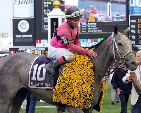 Actress with Nik Juarez after winning the 93rd Running of the Black-Eyed Susan at Pimlico on May 19, 2017.
