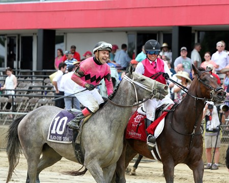 Nik Juarez celebrates after winning the 93rd Running of the Black-Eyed Susan at Pimlico on May 19, 2017 aboard Actress.