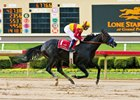 Danzing Candy is 4 3/4 lengths in front at the wire in the May 28 Lone Star Park Handicap