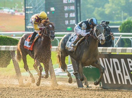 Tapwrit with jockey Jose Ortiz passes Irish War Cry with jockey Rajiv Maragh to win the 149th running of the Belmont States June 10, 2017 in Elmont, N.Y.