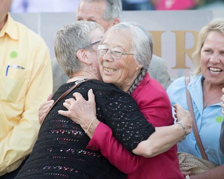 McCraken owner Janis Whitham gets congratulatory hug after win