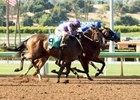 Faypien (between horses) wins the Summertime Oaks