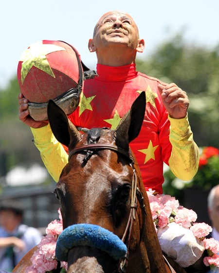 Mike Smith celebrates after winning the 87th Running of the Acorn at Belmont Park on June 10, 2017.