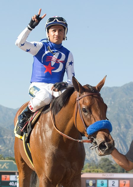 Faypien and jockey Rafael Bejarano are guided into the winner's circle after their victory in the Grade II, $200,000 Summertime Oaks, Saturday, June 17, 2017 at Santa Anita Park, Arcadia CA.