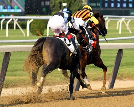 Tapwrit chasing Irish War Cry in the stretch of the 149th Running of the Belmont Stakes at Belmont Park on June 10, 2017.