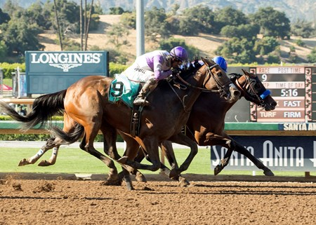Faypien and jockey Rafael Bejarano, right, outleg Mopotism (Mario Gutierrez), outside, and Spooky Woods (Flavien Prat), inside, to win the Grade II, $200,000 Summertime Oaks, Saturday, June 17, 2017 at Santa Anita Park, Arcadia CA.