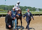 WinStar Farm's Kenny Troutt leads American Anthem into the Belmont Park winner's circle