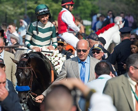 Owner Michael Lund Petersen walks in Mor Spirit with Mike Smith  wins the Mohegan Sun Metropolitan (G1) at Belmont Park  on June 10, 2017 in Elmont, New York.