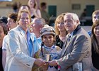 J. David Richardson (right) in winner's circle with jockey Joel Rosario and trainer Dallas Stewart