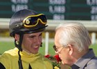 Racing Hall of Fame trainer Jerry Hollendorfer congratulates Evin Roman after the apprentice jockey earned his first stakes win in the Southern Truce Stakes on Street Surrender