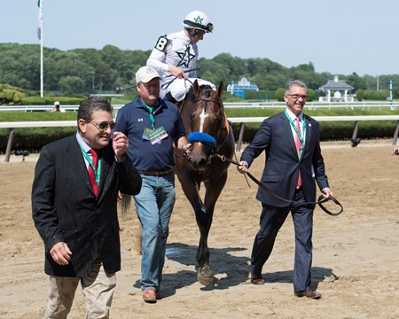 Kenny Troutt walks in American Anthem with Mike Smith wins the Woody Stephens Stakes (G2) at Belmont Park  on June 10, 2017 in Elmont, New York.