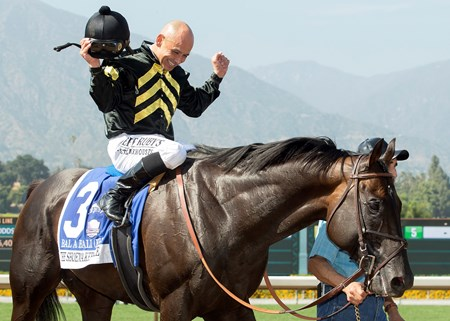 Calumet Farm's Bal a Bali and jockey Mike Smith are guided into the winner's circle after their victory in the Grade I, $400,000 Shoemaker Mile, Saturday, June 3, 2017 at Santa Anita Park, Arcadia CA.