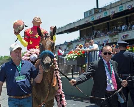 Owner walkin Abel Tasman with Mike Smith wins the Acorn Stakes (G1) at Belmont Park  on June 10, 2017 in Elmont, New York.
