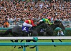 Satono Crown (pink cap) sprints past Gold Actor in the final strides of the  June 25 Takarazuka Kinen
