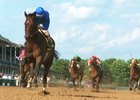 Street Cry overwhelms rivals in the 2002 Stephen Foster Handicap