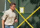 Dr. Tim DeLatte, an attending veterinarian, leaves the quarantine area at Belmont Park