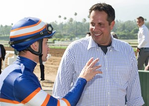 Trainer Phil D'Amato speaks with jockey Flavien Prat at Santa Anita