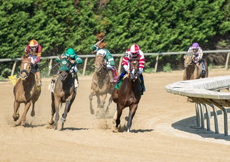 Songbird, with Mike Smith aboard, leading the field at the final turn of the Delaware Handicap on July 15th, 2017 at Delaware Park