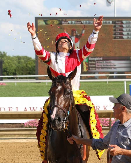 Mike Smith celebrates after winning the Delaware Handicap (GI) aboard Songbird at Delaware Park on July 15, 2017.