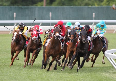 Bigger Picture #3 (Right, rear) with Joe Bravo riding begins to rally off the turn, passing the field and Can'thelpbelieving #7 and Paco Lopez in deep stretch to win the $300,000 Grade 1 United Nations at Monmouth Park in Oceanport, New Jersey on Saturday July 1, 2017.