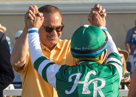 Owner Kosta Hronis, left, celebrates with jockey Victor Espinoza, right, after Accelerate's victory in the 2017 TVG San Diego Handicap, Saturday, July 22, 2017 at Del Mar Thoroughbred Club, Del Mar CA.