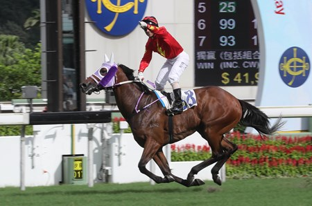Brett Prebble steers Hang's Decision to win the Class 2 Hong Kong Reunification Cup Handicap (1400m) in a course record time.