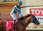 Jockey Victor Espinoza celebrates after his victory aboard Accelerate in the San Diego Handicap