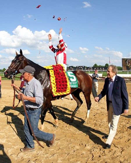 Songbird, Mike Smith, and Rick Porter head to the winner's circle after the Delaware Handicap at Delaware Park on July 15, 2017.