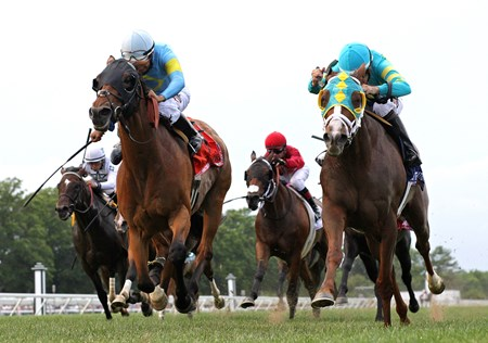 Bigger Picture #3 (R) with Joe Bravo riding passed Can'thelpbelieving #7 and Paco Lopez in deep stretch to win the $300,000 Grade 1 United Nations at Monmouth Park in Oceanport, New Jersey on Saturday July 1, 2017.