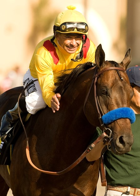 Richard's Kid and jockey Mike Smith are guided into the winner's circle after their victory in the Grade I, $1,000,000 Pacific Classic for the second consecutive year, August 28, 2010 at Del Mar Thoroughbred Club, Del Mar CA.