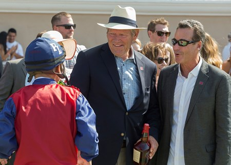 Owner's Alan Klein, right, and Phil Lebherz, second from left, celebrate with jockey Mike Smith, left, after Miss Sunset's victory in the 2017 Fleet Treat Stakes
