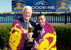 Frank Stronach and jockey Luis Contreras celebrate Holy Helena's Queen's Plate win in the winner's circle July 2 at Woodbine.
