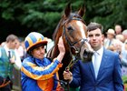 Ryan Moore (left) poses with Clemmie after their victory in the Duchess of Cambridge Stakes