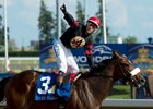 Jockey Luis Contreras celebrates aboard Holy Helena as they cross the finish line in the Queen's Plate