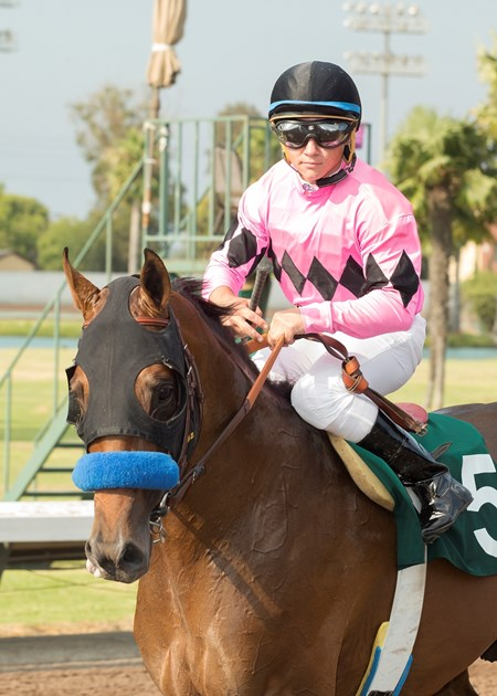 Jockey Drayden Van Dyke guides West Coast to the winner's circle after their victory in the G3, $200,000 Los Alamitos Derby, Saturday, July 15, 2017 at Los Alamitos Race Course, Cypress Ca.