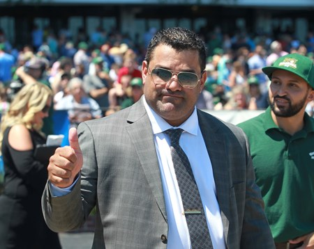 Trainer Jorge Navarro gives the thumbs up after Sharp Azteca wins the 2017 Monmouth Cup (G3)
