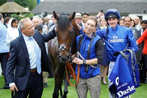 Harry Angel with trainer Clive Cox (left) after winning last year's Darley July Cup