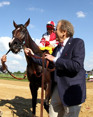 Songbird, jockey Mike Smith, and owner Rick Porter after the filly's win in the Delaware Handicap