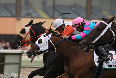 Ben's Cat #5 (L) with Julian Pimentel riding edged out Chamberlain Bridge #11 (C) 2nd  with Paco Lopez and Great Mills (R) with Frankie Pennington third in the $350,000 Grade III Turf Monster Handicap at Parx Racing in Bensalem, PA on Monday September 3, 2012.